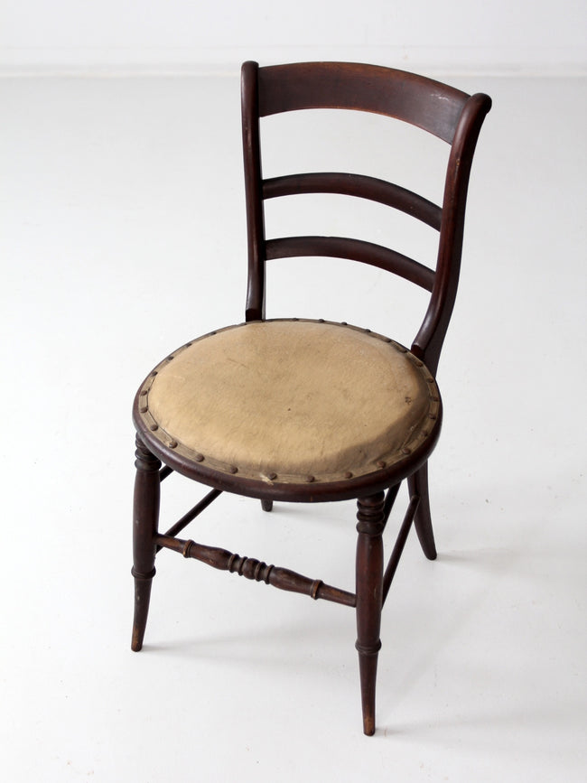 antique accent chair with ladder back