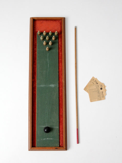 vintage tabletop bowling game with cue stick
