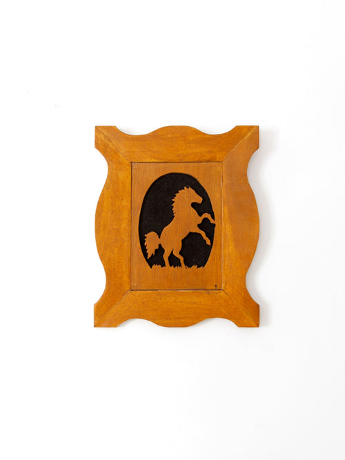vintage horse silhouette art on wood