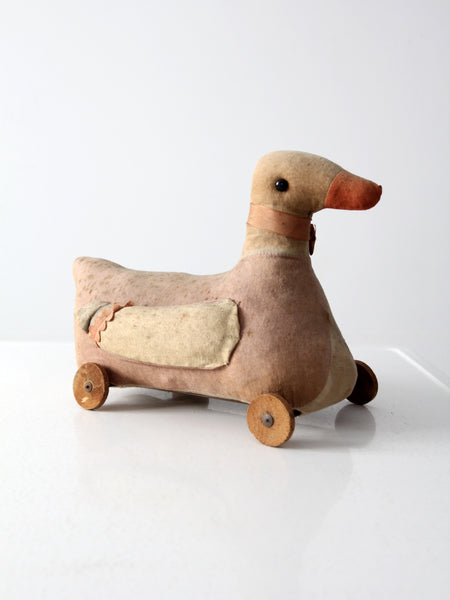 antique toy duck on wheels