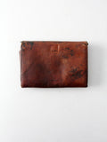 antique leather clutch with art nouveau tooling