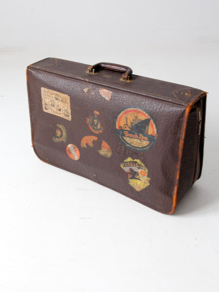 vintage leather suitcase with travel stickers