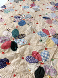 vintage hand tied quilt in Dresden plate style