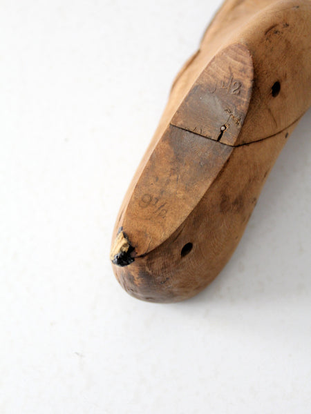 antique cobbler's shoe form with leather patching