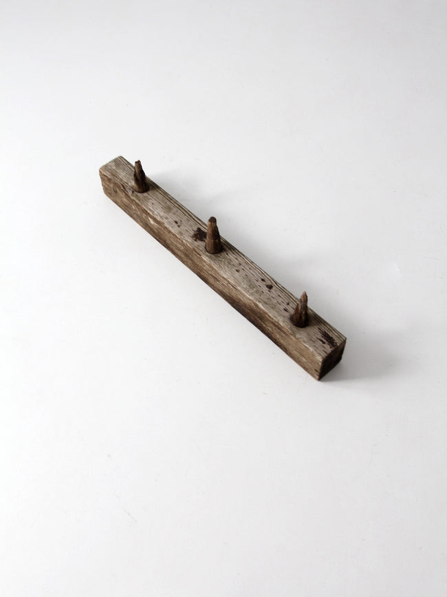 antique wooden peg post