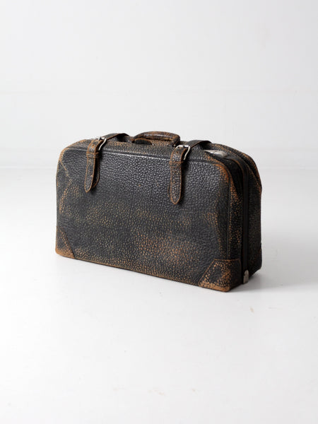 black leather suitcase circa 1930