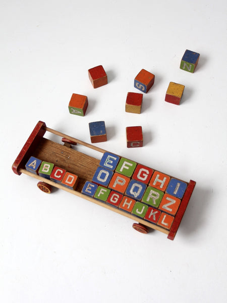 vintage Halsam toy cart with wooden blocks