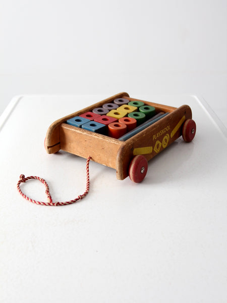 vintage Playskool wagon with wooden toy blocks