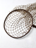 antique fish net on pole