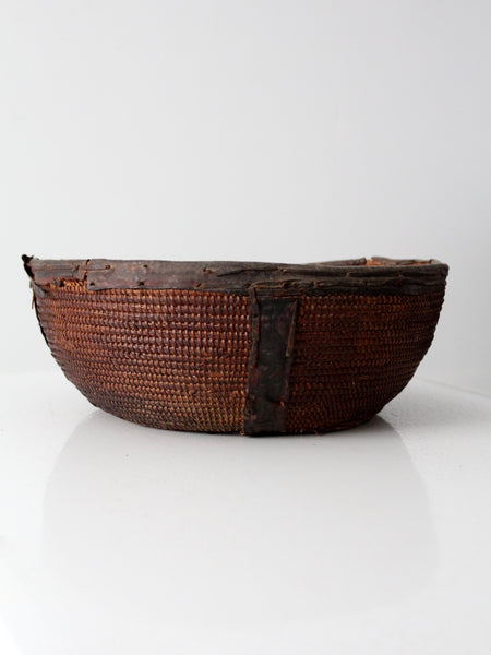 African coil bowl with leather