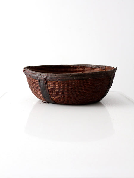 African basket bowl with leather