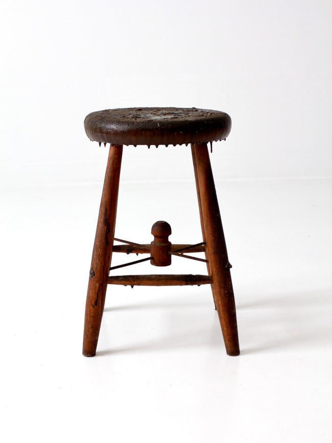 antique wooden stool with wire stretcher