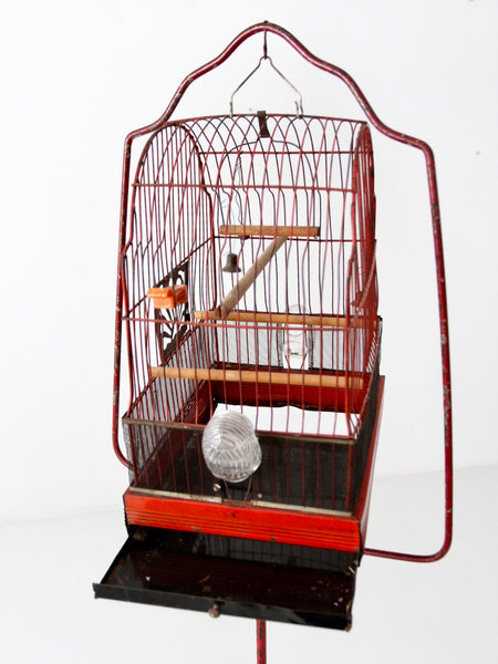 antique bird cage with cast iron stand