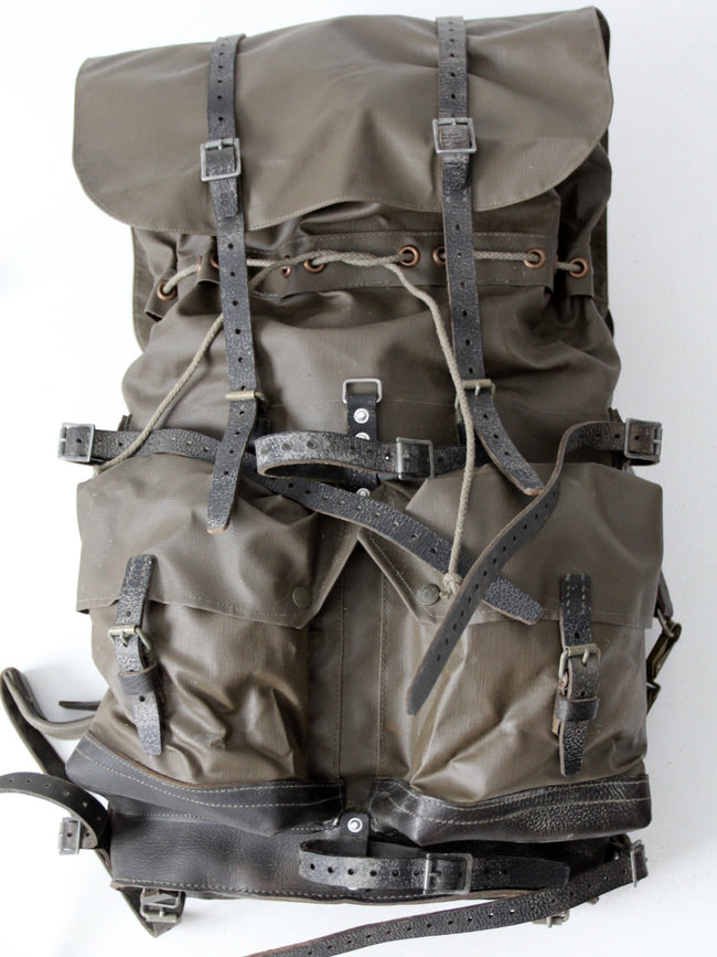 vintage Swiss army backpack with hiking tools