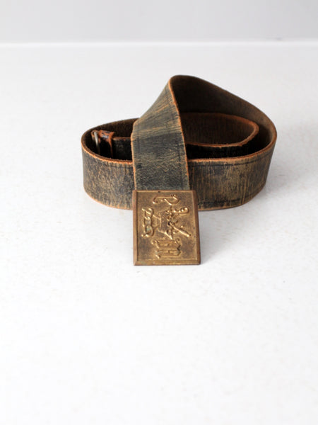 vintage 70s tooled leather belt with zodiac buckle