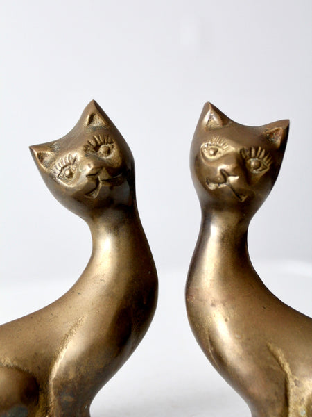 mid-century brass cats - a pair
