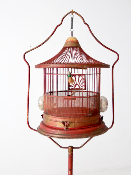 antique bird cage on stand