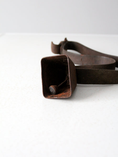 antique cowbell on strap
