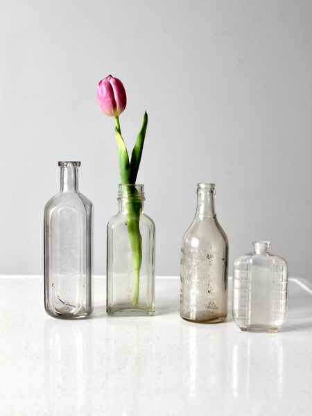 antique glass apothecary bottle set of 4