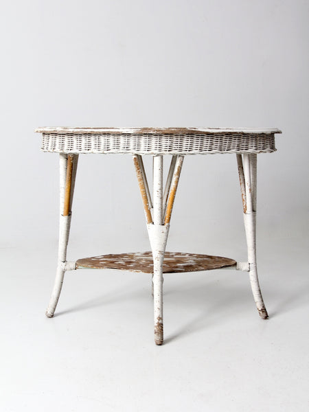 antique white wicker side table