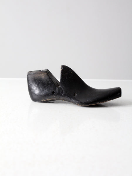 antique black wooden shoe form