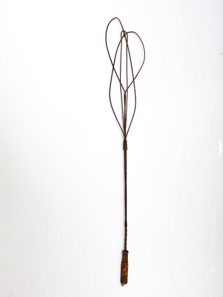 antique rug beater