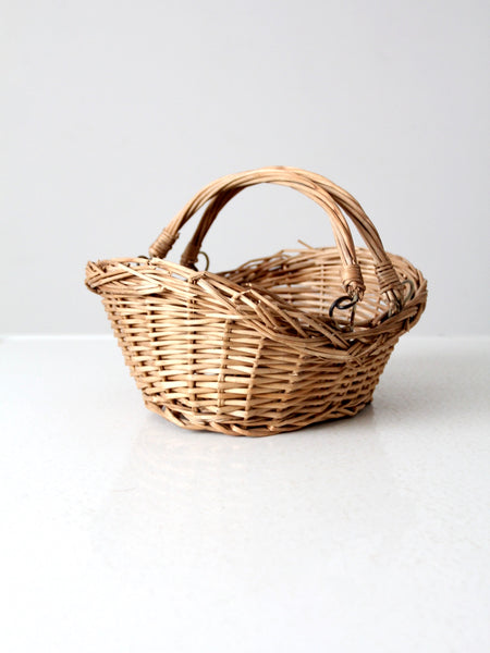 antique basket with folding legs