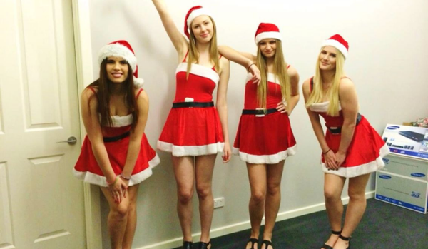 Four girls wearing mean christmas costumes