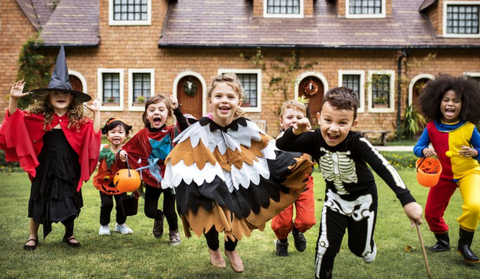 Kids playing in halloween party costumes