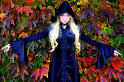 Young Woman In Halloween Autumn Witch Costume