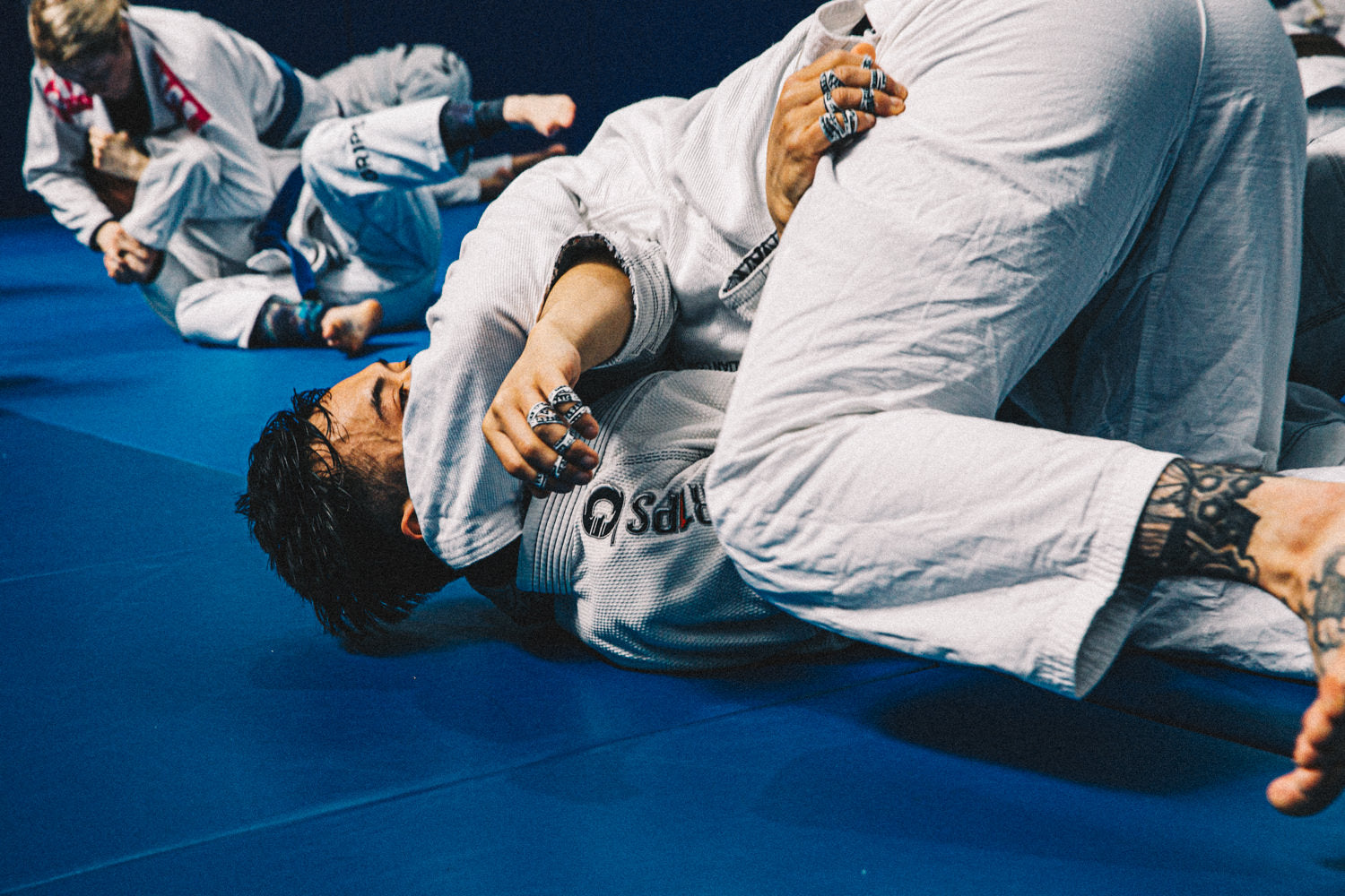 Two grapplers in gi wearing Jitsy finger tape