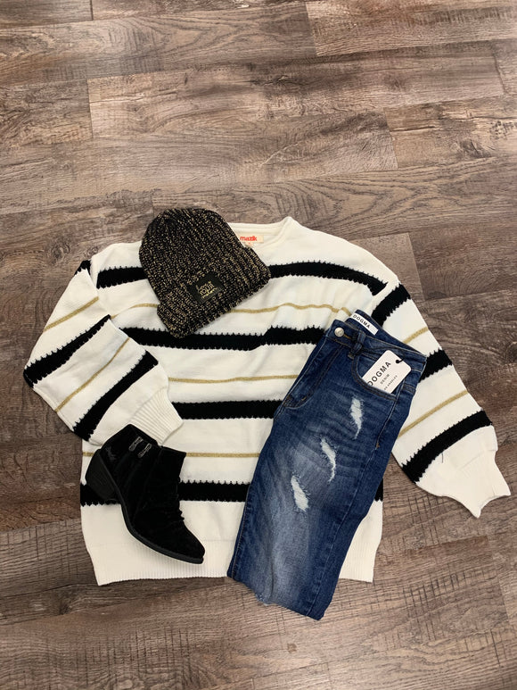 White, Black, and Gold Sweater
