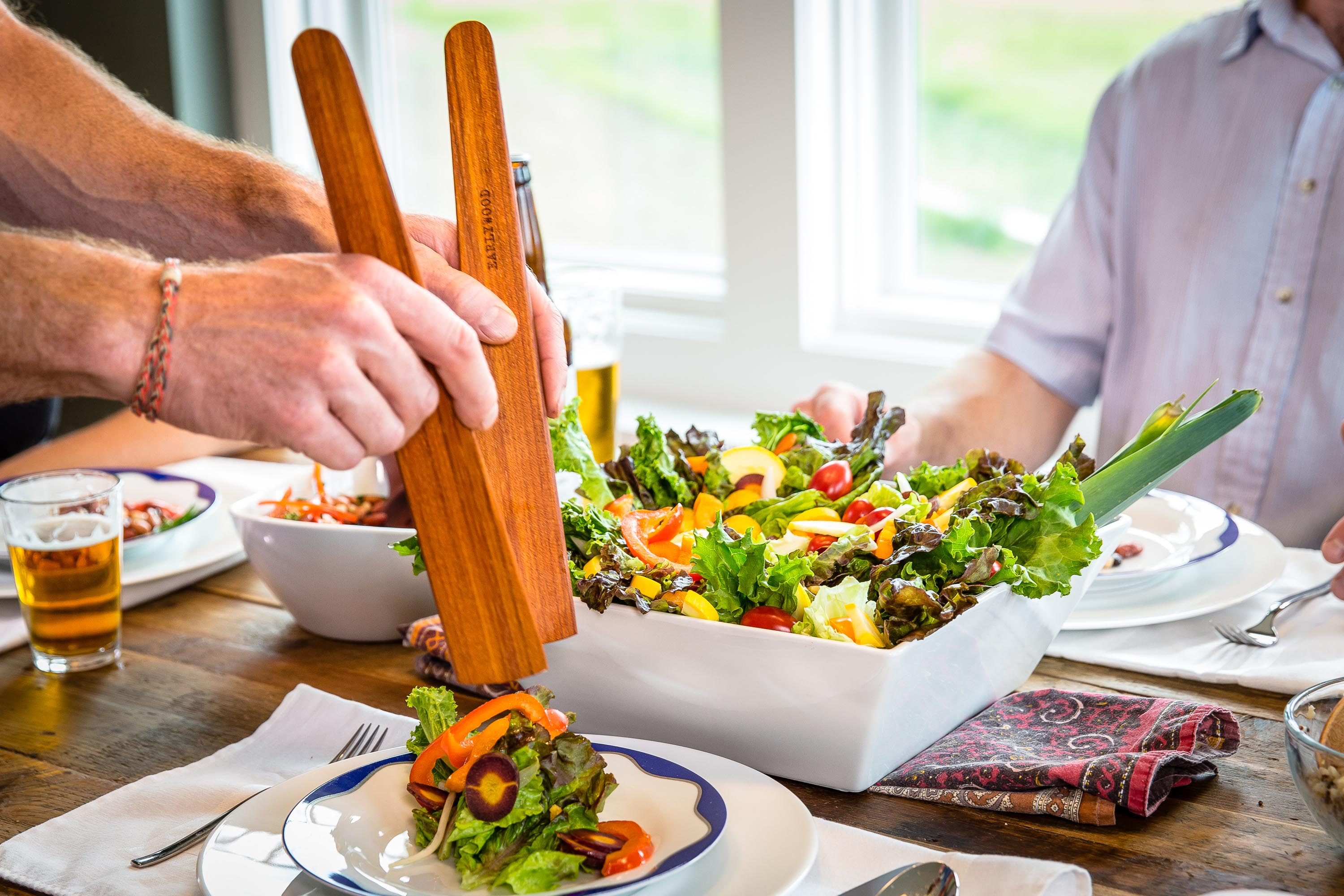 Two wood spatulas for serving salad