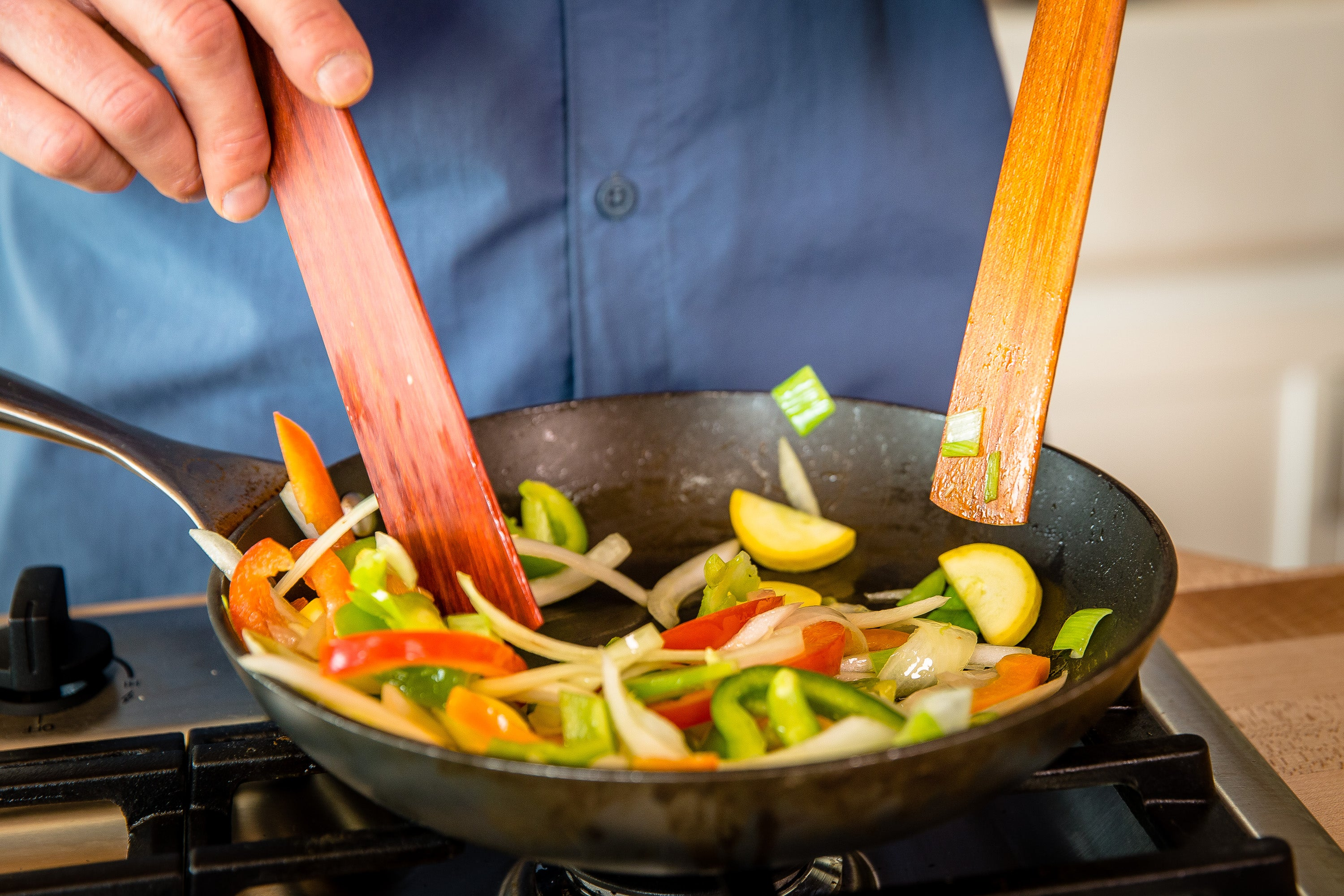 Using head or blade of wooden spatula for sautéing