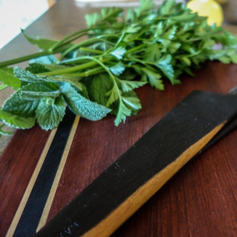 wooden utensils cutting board scraper fresh herbs