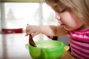 wooden feeding spoon in use by toddler - Earlywood