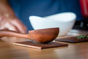 big hardwood ladle sitting on spoon rest - Earlywood