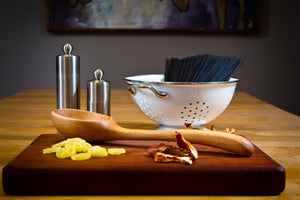 hard maple ladle sitting on cutting board - Earlywood