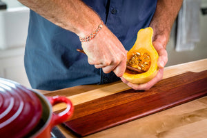 wood cheese knife scooping seeds out of squash - Earlywood