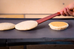flipping pancakes with thin wood utensils for nonstick cookware - Earlywood