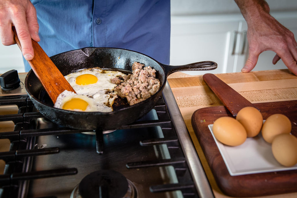 using Earlywood tera scraper to cook eggs in cast iron pan