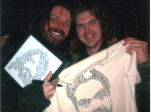 Simon Neil and his drawinside picture with doodles