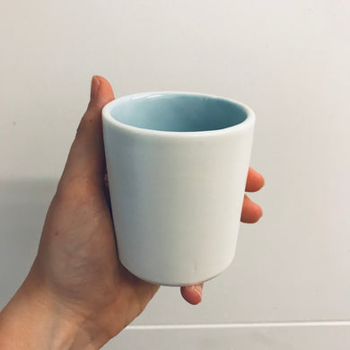 Beaker with coloured interior