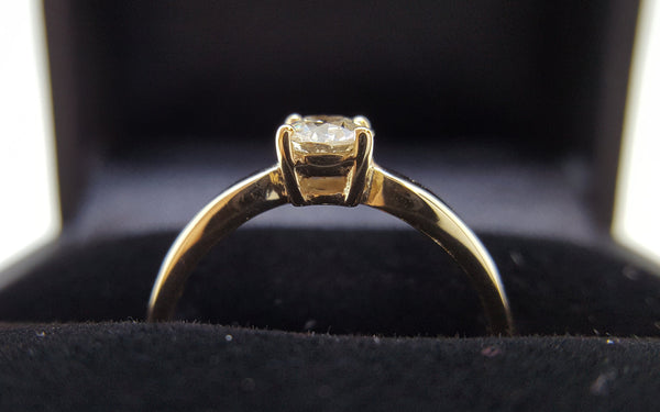 9 karat yellow gold four claw vintage design engagement ring with diamond