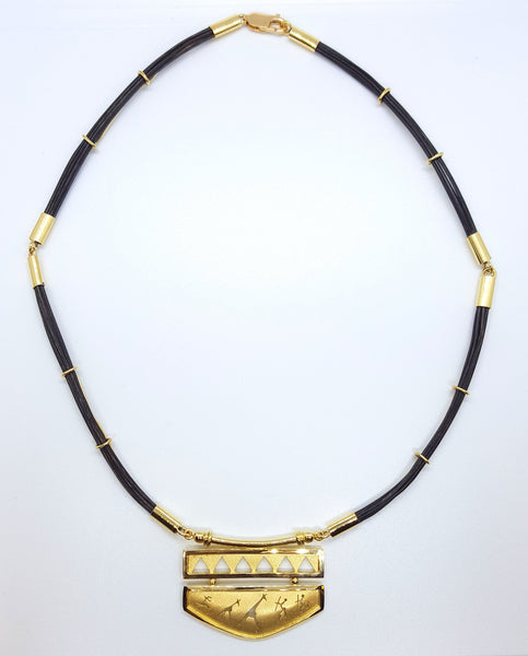18 karat yellow gold africa rock art necklace with elephant hair