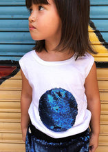 Load image into Gallery viewer, Feeling blue? White cotton t-shirt, sleeveless, with a big full moon on the front, completely embroidered in blue sequins. The fun starts when you comb the sequins with your hand for cool textures. It´s a super glam basic. Not-so-basic-basics.