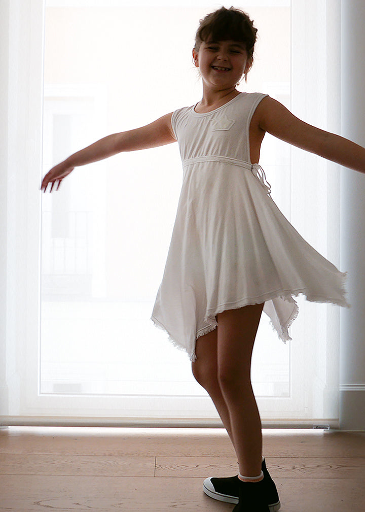 Light-as-air white 100% cotton dress, soft and fresh to dream about. Raw edges and a reflective crown on the front. Very wide armholes and back, unbeatable for a beach look or a summer party. We are just in love with white.