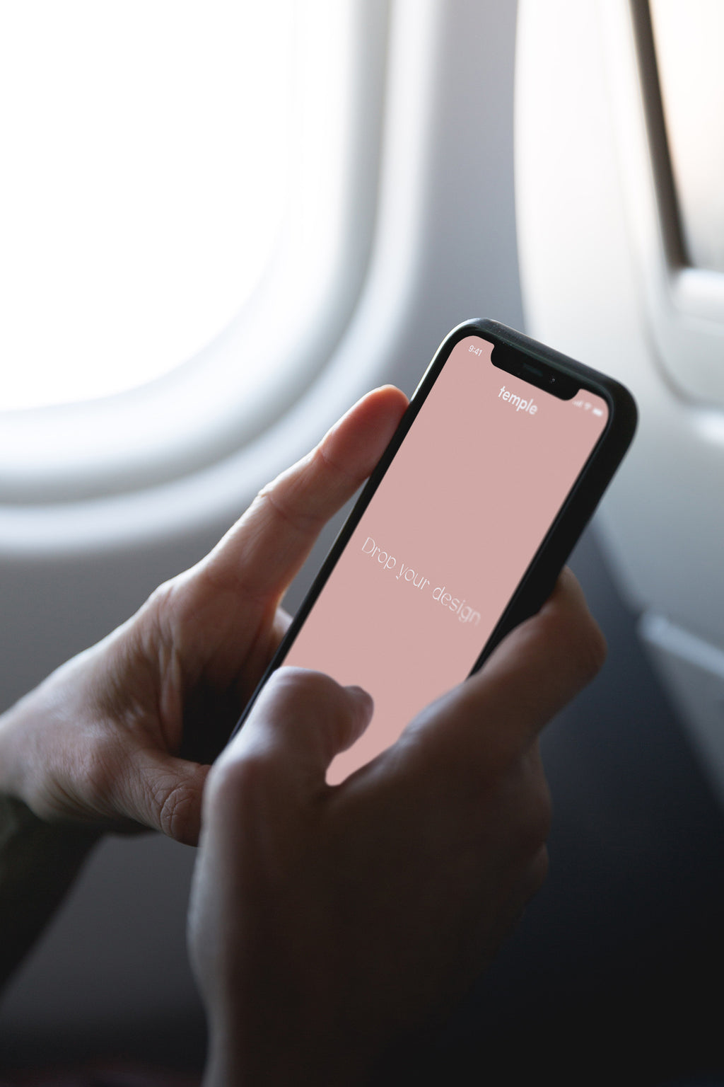 In Airplane With iPhone X Mockup