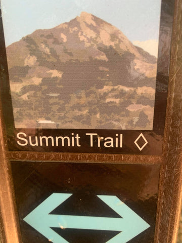 The trail signage showing the Black Diamond rating