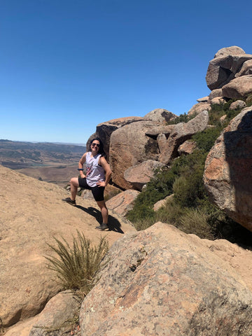 Jillian stands upon the top of a Volcano